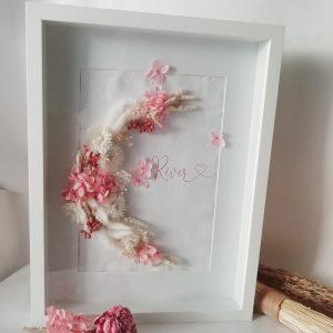 Cadre blanc fleurs séchées